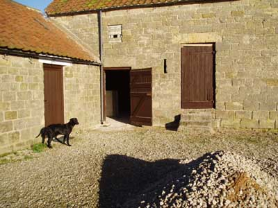 In 2004 the outbuildings look like that: Two stable doors into the barn.